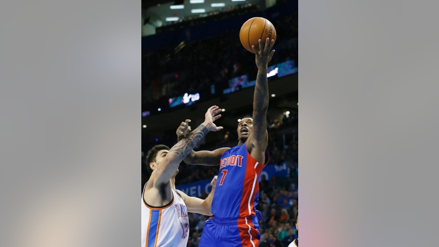 Detroit Pistons' Brandon Jennings (7) shoots in front of Oklahoma City Thunder's Steven Adams (12) during the first quarter of an NBA basketball game in Oklahoma City, Friday, Nov. 14, 2014. (AP Photo/Sue Ogrocki)
