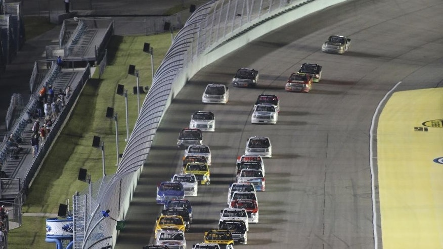 Vehicles start the NASCAR Trucks series auto race, Friday, Nov. 14, 2014, in Homestead, Fla. (AP Photo/Jim Topper)