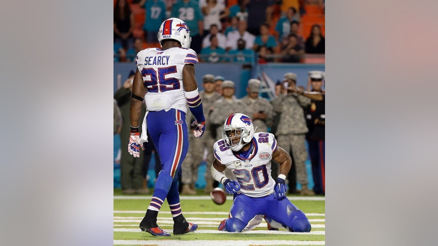 Buffalo Bills cornerback Corey Graham (20) reacts after missing an interception in the second half of an NFL football game against the Miami Dolphins in Miami Gardens, Fla., Thursday, Nov. 13, 2014. (AP Photo/Alan Diaz)