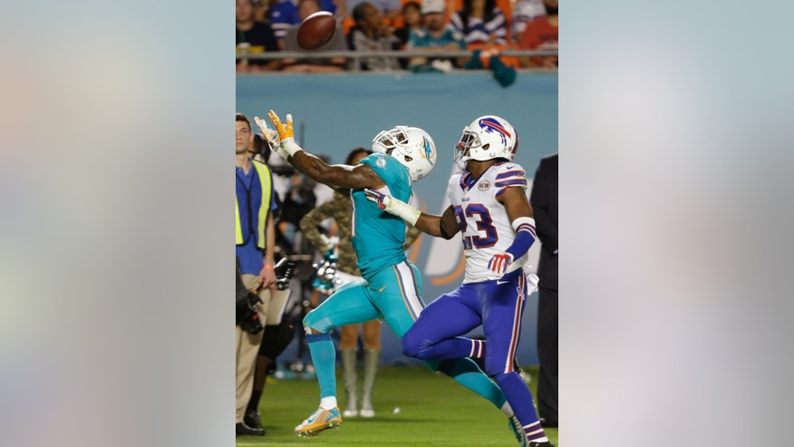 Miami Dolphins wide receiver Mike Wallace, left, can't make a catch as Buffalo Bills free safety Aaron Williams (23) defends during the first half of an NFL football game, Thursday, Nov. 13, 2014, in Miami Gardens, Fla. (AP Photo/Lynne Sladky)