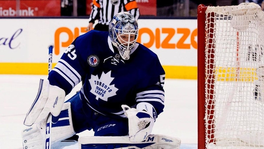 Toronto Maple Leafs goaltender Jonathan Bernier makes a save during the first period of NHL hockey action against the Pittsburgh Penguins in Toronto on Friday, Nov. 14, 2014. (AP Photo/The Canadian Press, Darren Calabrese)