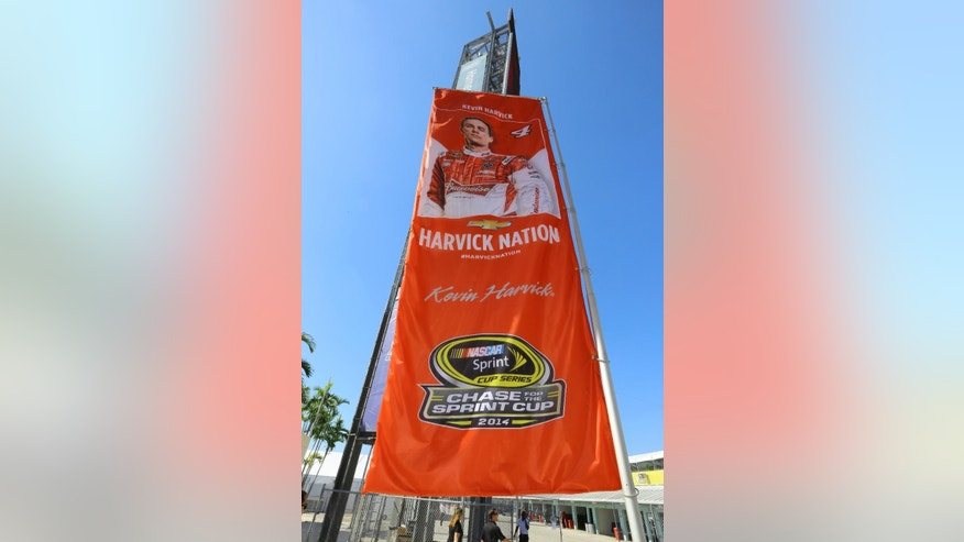 A Kevin Harvick banner hangs at the Homestead Miami Speedway Friday, Nov. 14, 2014, in Homestead, Fla. Harvick will race Denny Hamlin, Joey Logano and Ryan Newman in the 2014 finale on Nov. 16, at Homestead. (AP Photo/David Graham)
