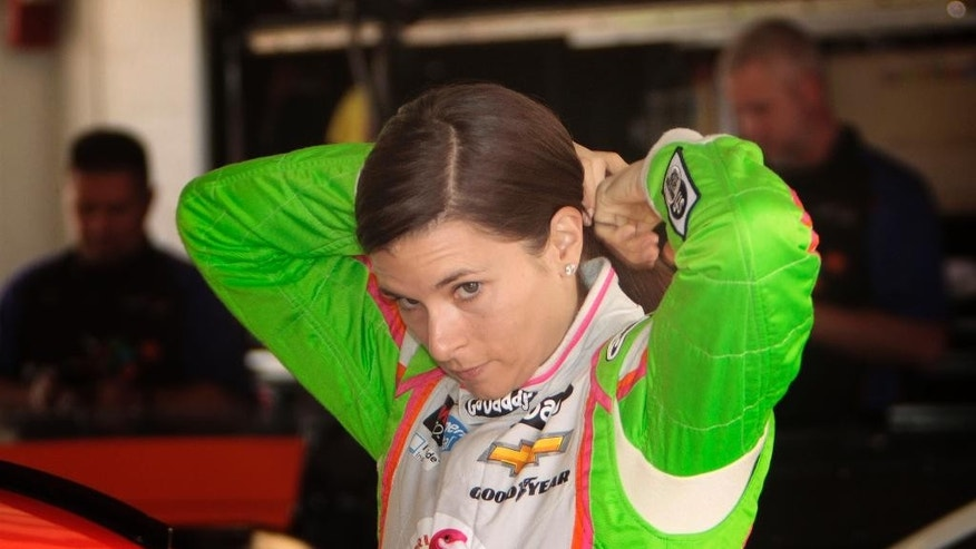 NASCAR driver Danica Patrick waits to drive practice laps at Homestead-Miami Speedway for the EcoBoost 400 auto race, Friday, Nov. 14, 2014, in Homestead, Fla. (AP Photo/Darryl Graham)