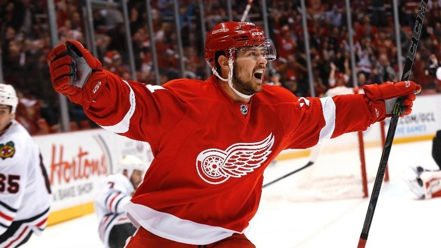 Detroit Red Wings left wing Tomas Tatar celebrates his goal against the Chicago Blackhawks in the second period of an NHL hockey game in Detroit, Friday, Nov. 14, 2014. (AP Photo/Paul Sancya)