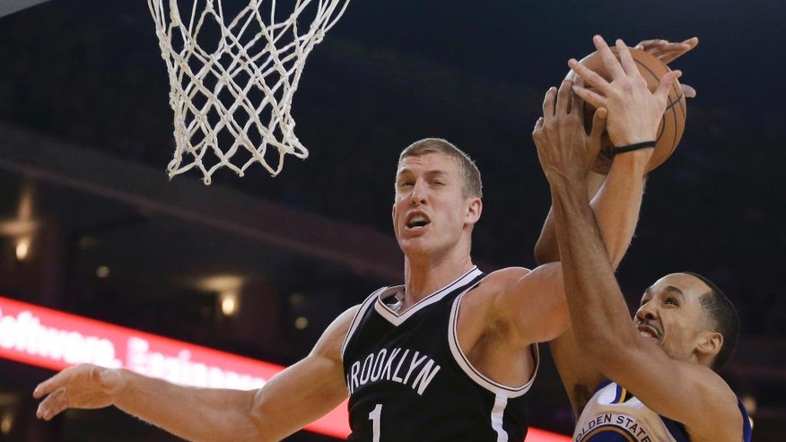 Brooklyn Nets' Mason Plumlee, left, and Golden State Warriors' Shaun Livingston (34) vie for a rebound during the first half of an NBA basketball game Thursday, Nov. 13, 2014, in Oakland, Calif. (AP Photo/Ben Margot)