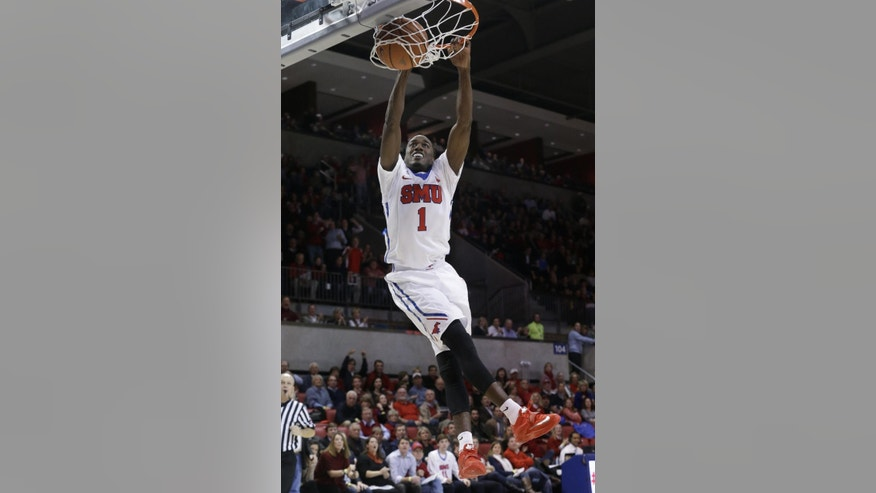 SMU guard Ryan Manuel (1) slam dunks during the first half of an NCAA college basketball game against Lamar, Friday, Nov. 14, 2014, in Dallas. (AP Photo/LM Otero)