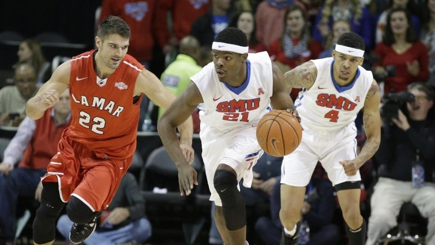 SMU guard Ben Emelogu (21) comes up with the steal against Lamar guard Preston Mattingly (22) as SMU's Keith Frazier (4) looks on during the first half of an NCAA college basketball game, Friday, Nov. 14, 2014, in Dallas. (AP Photo/LM Otero)