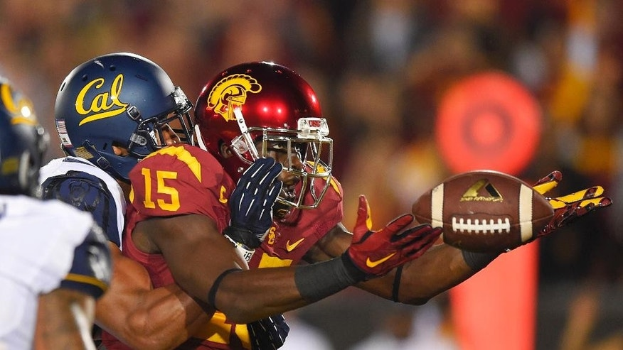 Southern California wide receiver Nelson Agholor, right, can't hold on to a pass in the end zone under pressure from California safety Stefan McClure during the first half of an NCAA college football game Thursday, Nov. 13, 2014, in Los Angeles. (AP Photo/Mark J. Terrill)