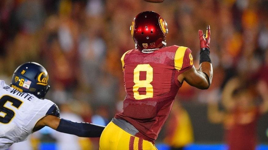 Southern California wide receiver George Farmer, right, makes a touchdown catch as California cornerback Darius White defends during the first half of an NCAA college football game, Thursday, Nov. 13, 2014, in Los Angeles. (AP Photo/Mark J. Terrill)
