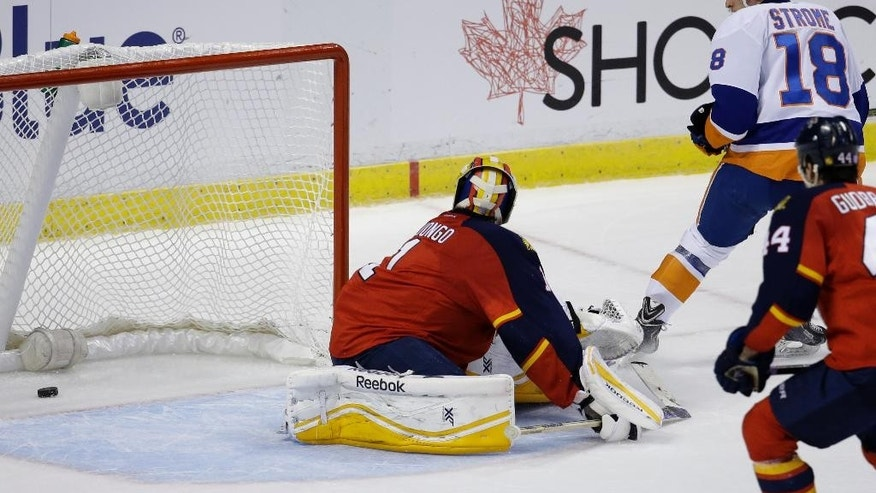 Florida Panthers goalie Roberto Luongo (1) looks behind after New York Islanders center Ryan Strome (18) scored a goal in the second period of an NHL hockey game, Friday, Nov. 14, 2014, in Sunrise, Fla. (AP Photo/Lynne Sladky)