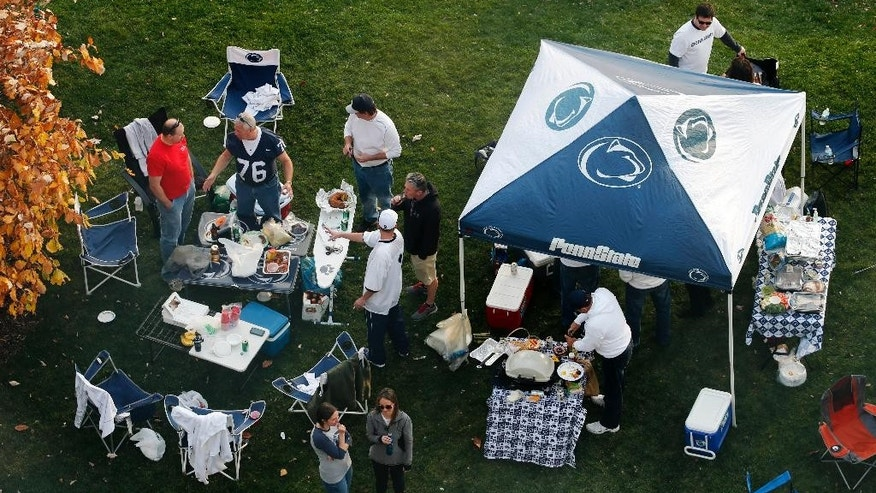 FILE - In this Oct. 25, 2014, file photo, Penn State fans tailgate outside Beaver Stadium before an NCAA college football game between Penn State and the Ohio State in State College, Pa. Ahead of the college football season, The Associated Press asked its panel of voters in the Top 25 poll to weigh in on the spots around the country to tailgate. Penn State ranked sixth. (AP Photo/Gene J. Puskar, File)