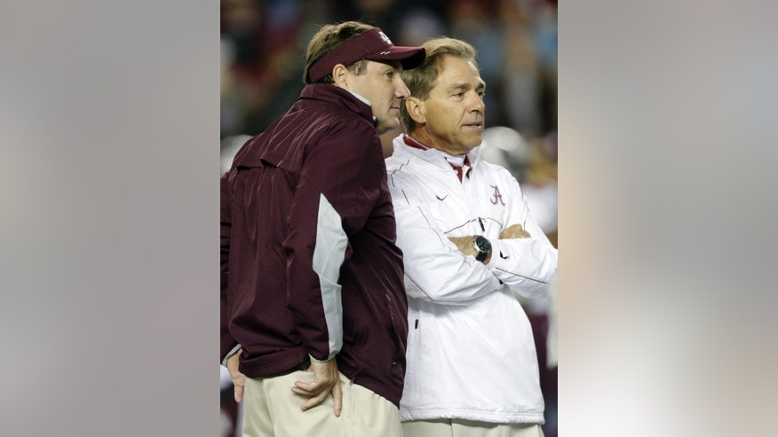 FILE - In this Oct. 27, 2012, file photo, Alabama coach Nick Saban, right, talks with Mississippi State coach Dan Mullen prior to an NCAA college football game at Bryant-Denny Stadium in Tuscaloosa, Ala.  While No. 1 Mississippi State and No. 4 Alabama meet in a monster matchup with playoff implications, elsewhere around the nation plenty of teams are trying to attain more modest goals. (AP Photo/Dave Martin, File)