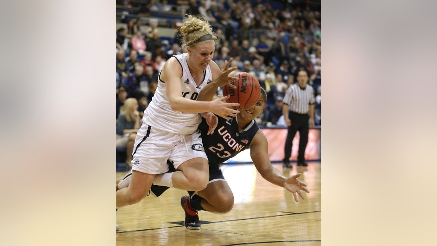 UC Davis forward Sydnee Fipps, left, and Connecticut  forward Kaleena Mosqueda-Lewis scramble for the ball during the second half of an NCAA women's college basketball game in Davis, Calif., Friday, Nov. 14, 2014.  Connecticut won 102-43.(AP Photo/Rich Pedroncelli)