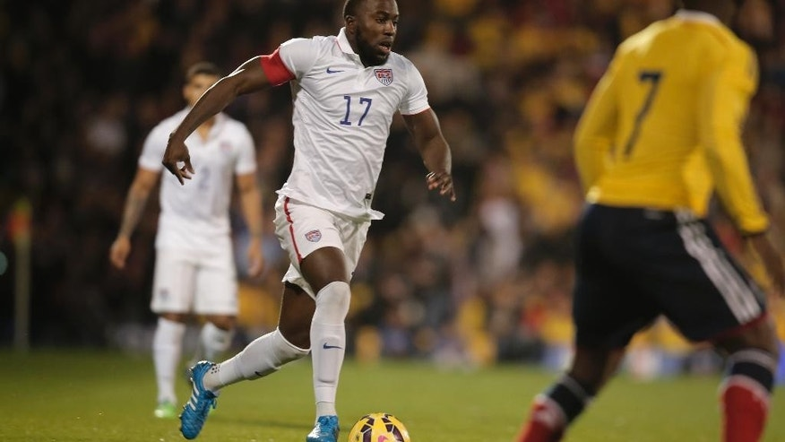 USA's captain Jozy Altidore, centre, controls the ball during an international friendly soccer match against Colombia at the Craven Cottage ground in London, Friday, Nov. 14, 2014. (AP Photo/Lefteris Pitarakis)