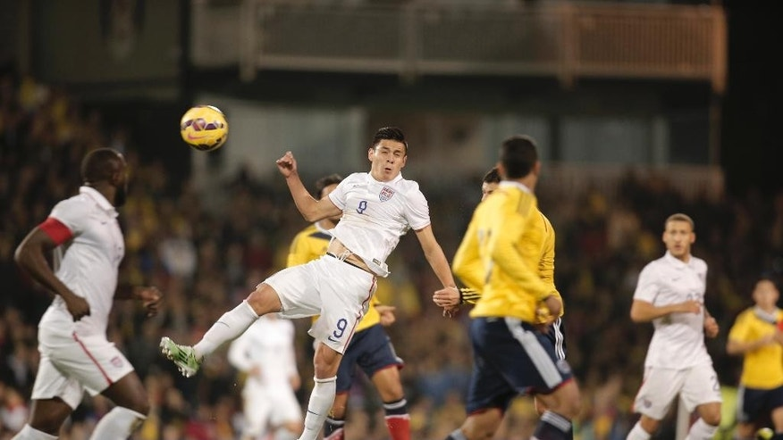 USA's Rubio Rubin, centre, heads the ball during an international friendly soccer match against Colombia at the Craven Cottage ground in London, Friday, Nov. 14, 2014. (AP Photo/Lefteris Pitarakis)