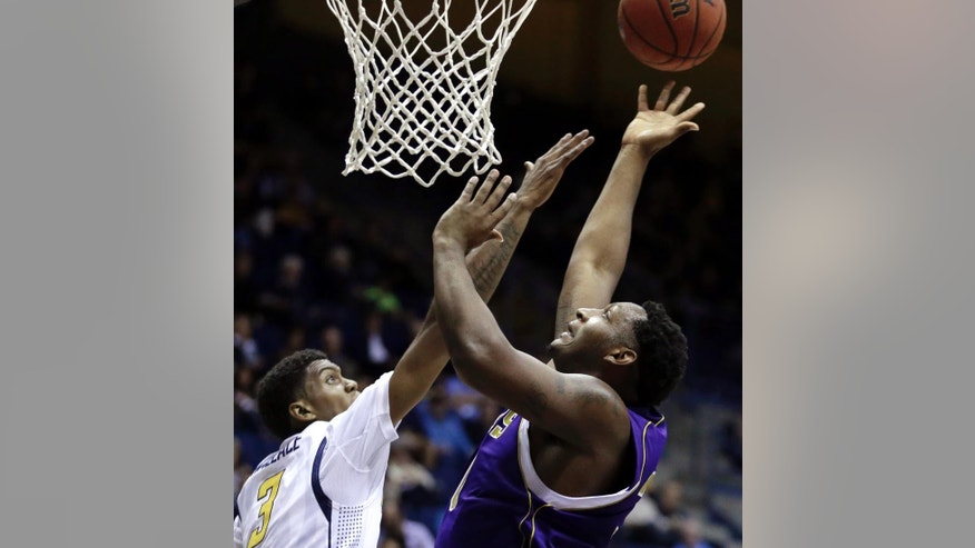 Alcorn State's Marquis Vance, right, lays up a shot against California's Tyrone Wallace (3) in the first half of an NCAA college basketball game Friday, Nov. 14, 2014, in Berkeley, Calif. (AP Photo/Ben Margot)