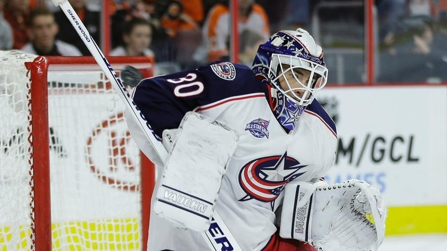 Columbus Blue Jackets' Curtis McElhinney blocks a shot during the second period of an NHL hockey game against the Philadelphia Flyers, Friday, Nov. 14, 2014, in Philadelphia. (AP Photo/Matt Slocum)