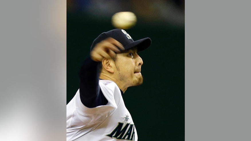 MLB All-Stars starter Hisashi Iwakuma throws a pitch against Japan in the fourth inning of Game 2 of their exhibition baseball series at Tokyo Dome in Tokyo, Friday, Nov. 14, 2014.  (AP Photo/Toru Takahashi)