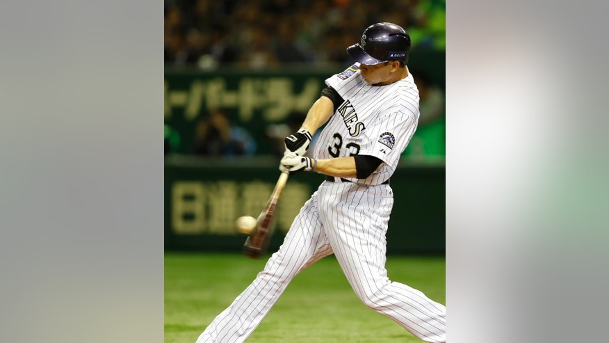 MLB All-Stars' Justin Morneau hits a two-run home run off Japan's starter Chihiro Kaneko in the second inning of Game 2 of their exhibition baseball series at Tokyo Dome in Tokyo, Friday, Nov. 14, 2014. (AP Photo/Toru Takahashi)