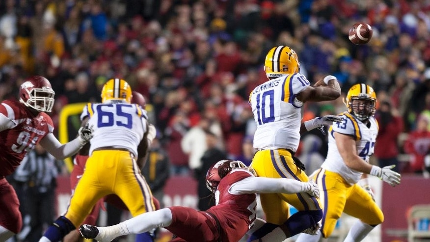 Arkansas linebacker Josh Williams (42) applies pressure to LSU quarterback Anthony Jennings (10) during the first half of an NCAA college football game in Fayetteville, Ark., Saturday, Nov. 15, 2014. (AP Photo/Sarah Bentham)