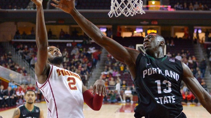 Southern California forward Malik Martin, left, puts up a shot as Portland State forward Tiegbe Bamba defends during the first half of an NCAA college basketball game, Saturday, Nov. 15, 2014, in Los Angeles. (AP Photo/Mark J. Terrill)