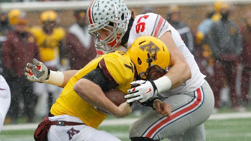 Ohio State defensive lineman Joey Bosa (97) sacks Minnesota quarterback Mitch Leidner during the first quarter of an NCAA college football game in Minneapolis Saturday, Nov. 15, 2014. (AP Photo/Ann Heisenfelt)