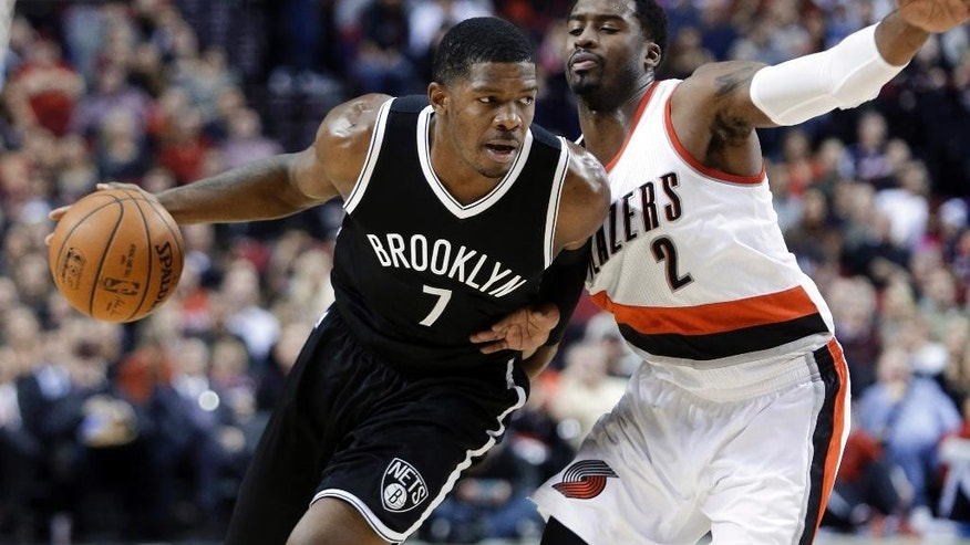 Brooklyn Nets guard Joe Johnson , left, drives past Portland Trail Blazers guard Wesley Matthews during the first half of an NBA basketball game in Portland, Ore., Saturday, Nov. 15, 2014. (AP Photo/Don Ryan)