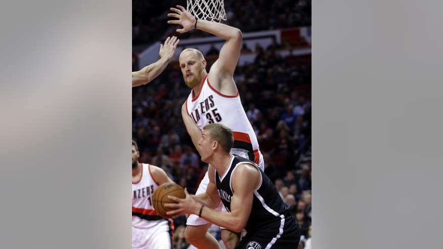 Brooklyn Nets forward Mason Plumlee, right, looks for an opening to the basket against Portland Trail Blazers center Chris Kaman during the first half of an NBA basketball game in Portland, Ore., Saturday, Nov. 15, 2014.(AP Photo/Don Ryan)