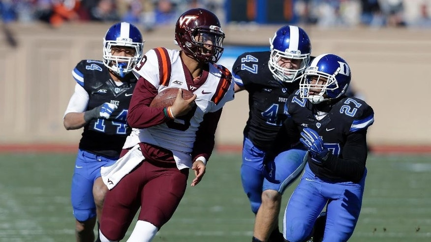 Duke's Bryon Fields (14), David Helton (47) and DeVon Edwards (27) chase Virginia Tech's Brenden Motley (9) during the first half of an NCAA college football game in Durham, N.C., Saturday, Nov. 15, 2014. (AP Photo/Gerry Broome)