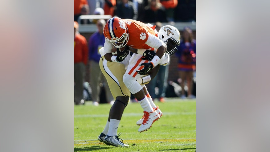 Clemson quarterback Deshaun Watson, right, is tackled by Georgia Tech's Quayshawn Nealy in the first quarter of an NCAA college football game, Saturday, Nov. 15, 2014, in Atlanta. (AP Photo/David Goldman)
