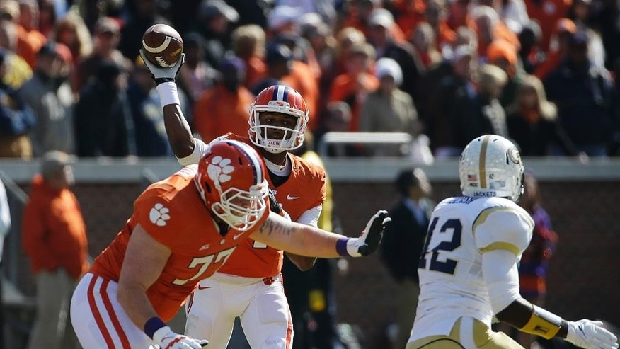 Clemson quarterback Deshaun Watson, rear, throws a pass as by teammate Reid Webster blocks during the first quarter of an NCAA college football game against Georgia Tech, Saturday, Nov. 15, 2014, in Atlanta. (AP Photo/David Goldman)