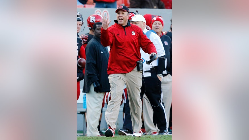N.C. State head coach Dave Doeren yells to the officials during the first half of an NCAA college football game against Wake Forest in Raleigh, N.C., Saturday, Nov. 15, 2014. (AP Photo/The News & Observer, Ethan Hyman)