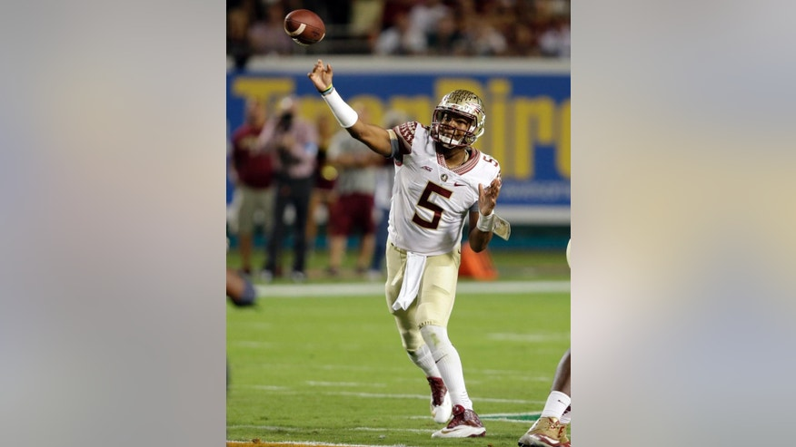 Florida State quarterback Jameis Winston (5) passes during the first half of an NCAA college football game against Miami, Saturday, Nov. 15, 2014, in Miami Gardens, Fla. (AP Photo/Wilfredo Lee)