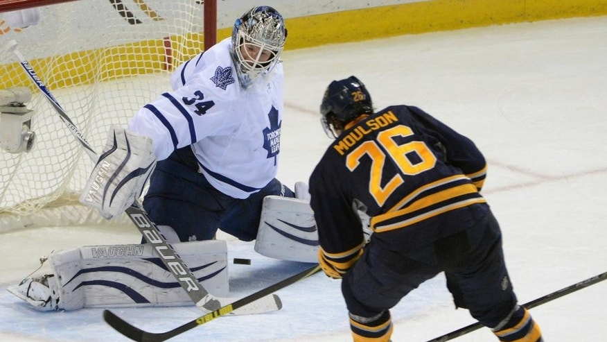 Toronto Maple Leafs goaltender James Reimer (34) gets beat by Buffalo Sabres left winger Matt Moulson (26) during the second period of an NHL hockey game Saturday, Nov. 15, 2014, in Buffalo, N.Y. (AP Photo/AdamWiepert)