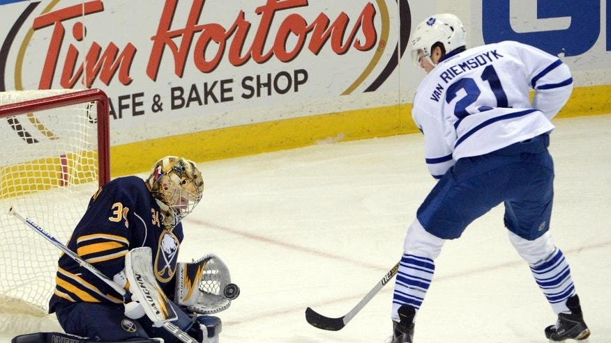 Buffalo Sabres goaltender Michal Neuvirth (34), of the Czech Republic, makes a breakaway save on Toronto Maple Leafs left winger James van Riemsdyk (21)    during the first period of an NHL hockey game Saturday, Nov. 15, 2014, in Buffalo, N.Y. (AP Photo/Adam Wiepert)