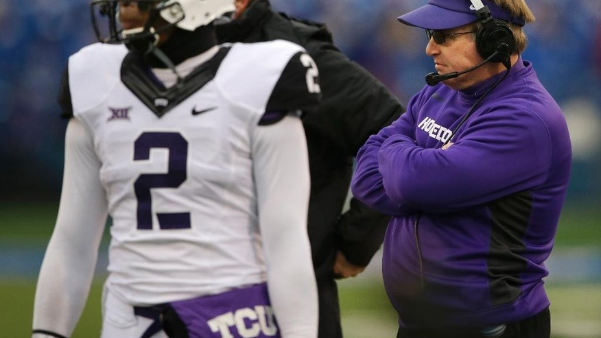 TCU head coach Gary Patterson, right, and quarterback Trevone Boykin (2) stand on the side line during a play review in the first half of an NCAA college football game in Lawrence, Kan., Saturday, Nov. 15, 2014. (AP Photo/Orlin Wagner)