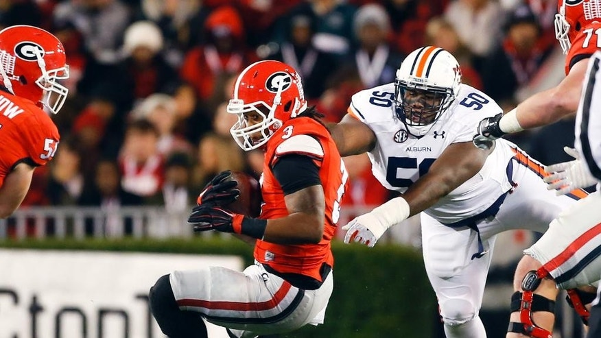 Georgia running back Todd Gurley (3) is stopped by Auburn defensive tackle Ben Bradley (50)in the first half of an NCAA college football game Saturday, Nov. 15, 2014, in Athens, Ga. (AP Photo/John Bazemore)