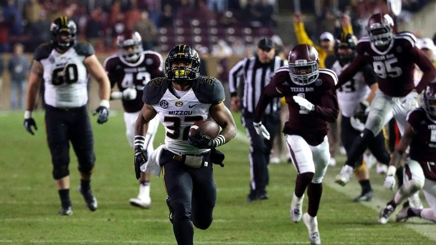 Missouri running back Russell Hansbrough (32) rushes 45 yards for a touchdown against Texas A&M during the second half of an NCAA college football game Saturday, Nov. 15, 2014, in College Station, Texas. (AP Photo/David J. Phillip)