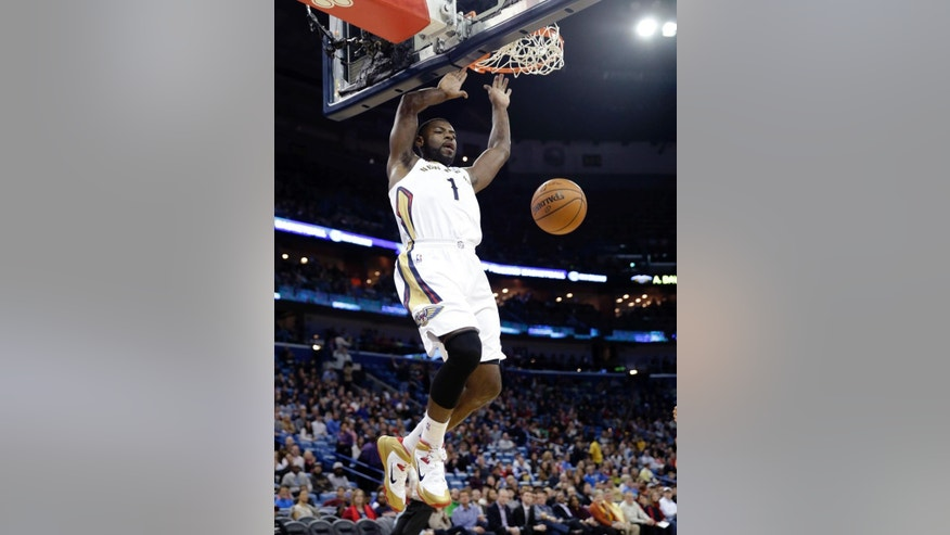 New Orleans Pelicans forward Tyreke Evans (1) slam-dunks in the first half of an NBA basketball game against the Minnesota Timberwolves in New Orleans, Friday, Nov. 14, 2014. (AP Photo/Gerald Herbert)