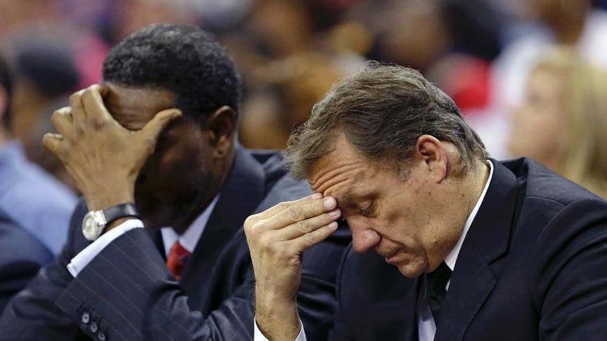 Minnesota Timberwolves head coach Flip Saunders, right, and assistant coach Sam Mitchell react in the fourth quarter of an NBA basketball game in New Orleans, Friday, Nov. 14, 2014. The Pelicans won 139-91. (AP Photo/Gerald Herbert)
