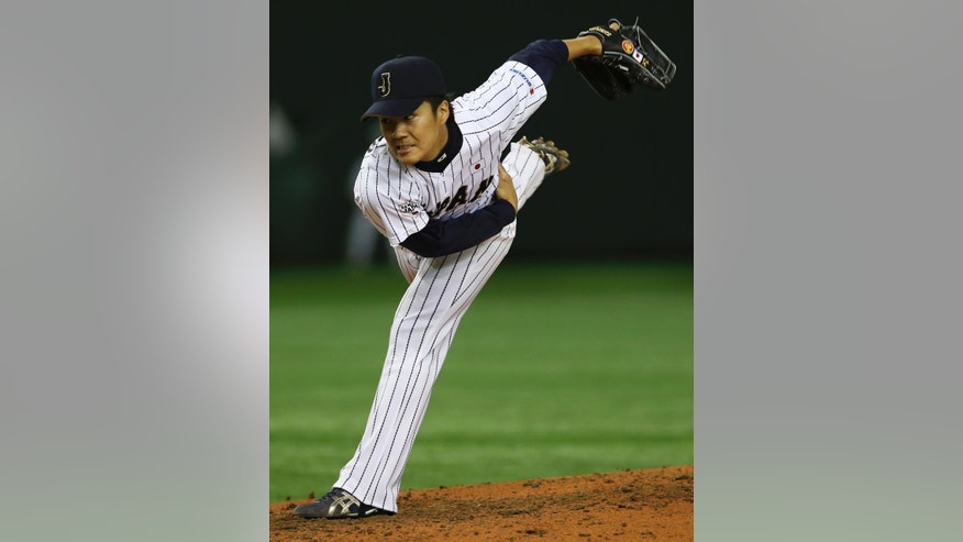 Japan's starter Takahiro Norimoto pitches against the MLB All-Stars in the third inning of Game 3 of their exhibition baseball series at Tokyo Dome in Tokyo, Saturday, Nov. 15, 2014. (AP Photo/Koji Sasahara)