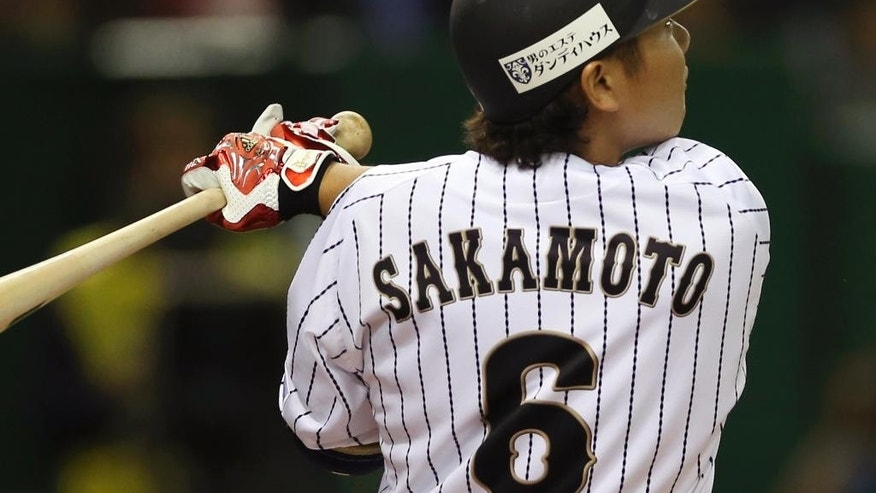 Japan's Hayato Sakamoto hits a two-run home run off MLB All-Stars starter Jeremy Guthrie in the second inning of Game 3 of their exhibition baseball series at Tokyo Dome in Tokyo, Saturday, Nov. 15, 2014. (AP Photo/Koji Sasahara)