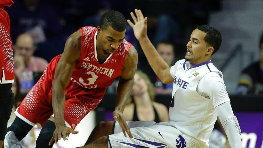 Southern Utah's Travon Langston (3) and Kansas State's Tre Harris chase a loose ball during the first half of an NCAA college basketball game Friday, Nov. 14, 2014, in Manhattan, Kan. (AP Photo/Charlie Riedel)