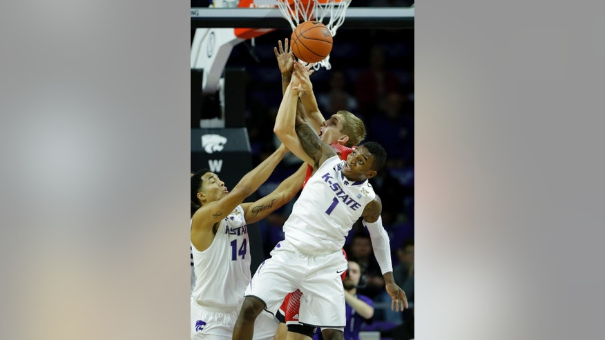 Kansas State's Justin Edwards (14) and Jevon Thomas (1) battle for a rebound with Southern Utah's James McGee during the first half of an NCAA college basketball game Friday, Nov. 14, 2014, in Manhattan, Kan. (AP Photo/Charlie Riedel)