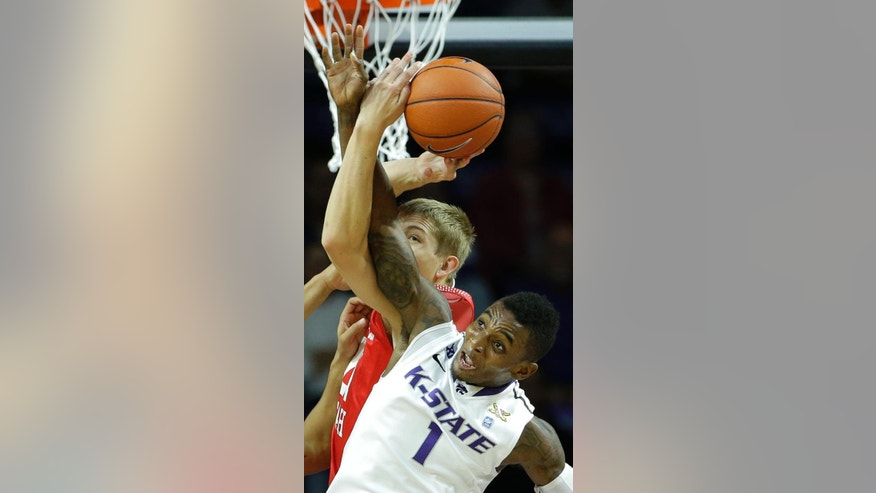 Kansas State's Jevon Thomas (1) and Southern Utah's James McGee battle for a rebound during the first half of an NCAA college basketball game Friday, Nov. 14, 2014, in Manhattan, Kan. (AP Photo/Charlie Riedel)