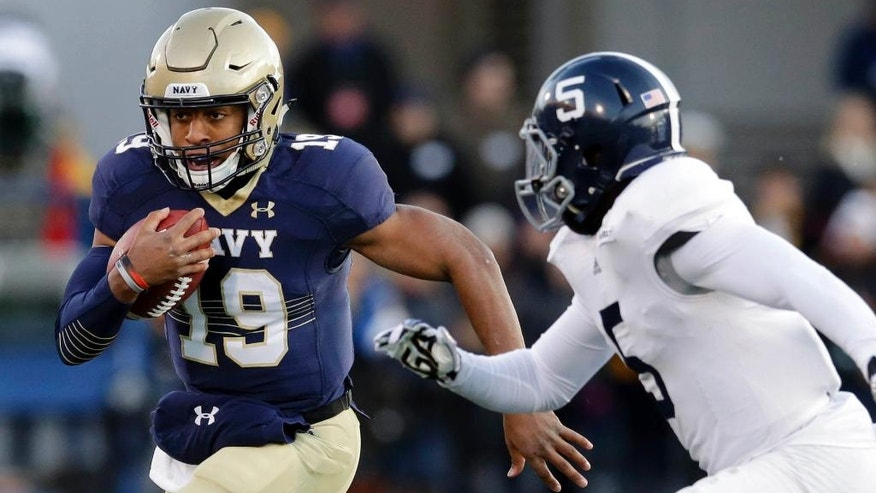 Navy quarterback Keenan Reynolds, left, rushes the ball around Georgia Southern cornerback Darius Jones in the first half of an NCAA college football game, Saturday, Nov. 15, 2014, in Annapolis, Md. (AP Photo/Patrick Semansky)
