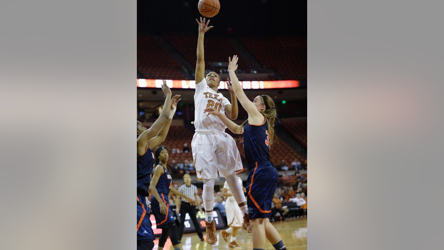 Texas' Brianna Taylor (20) shoots over UTSA's Carlie Heineman, right, during the first half of an NCAA college basketball game, Saturday, Nov. 15, 2014, in Austin, Texas. (AP Photo/Eric Gay)