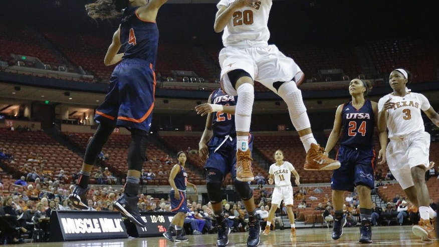 Texas' Brianna Taylor (20) shoots around UTSA's Crystal Chidomere (4) during the first half of an NCAA college basketball game, Saturday, Nov. 15, 2014, in Austin, Texas. (AP Photo/Eric Gay)