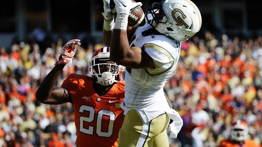Georgia Tech's DeAndre Smelter, right, catches a touchdown pass against Clemson's Jayron Kearse in the third quarter of an NCAA college football game, Saturday, Nov. 15, 2014, in Atlanta. (AP Photo/David Goldman)