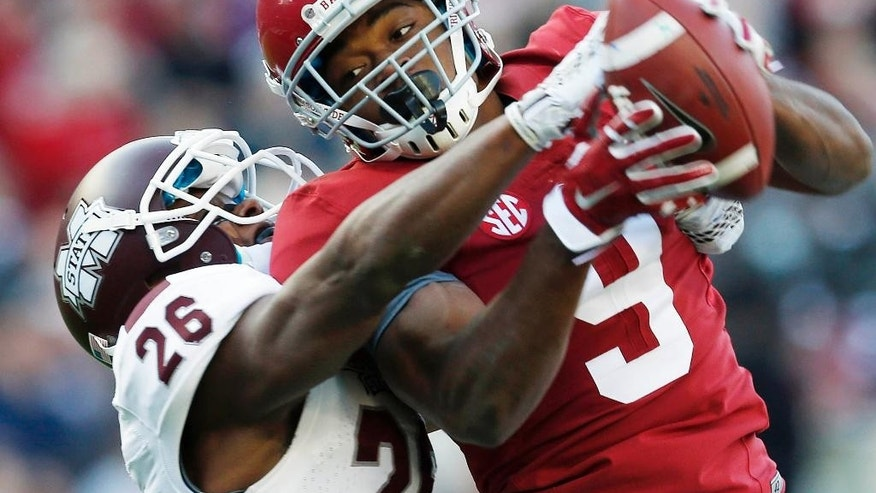Alabama wide receiver Amari Cooper (9) catches a 50-yard pass against Mississippi State defensive back Kendrick Market (26) in the first half of an NCAA college football game on Saturday, Nov. 15, 2014, in Tuscaloosa, Ala. (AP Photo/Butch Dill)